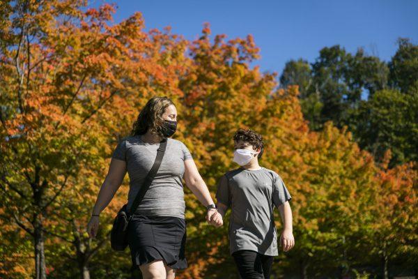 Mother and son walk at Gene Coulon Memorial Park in Renton, Washington.