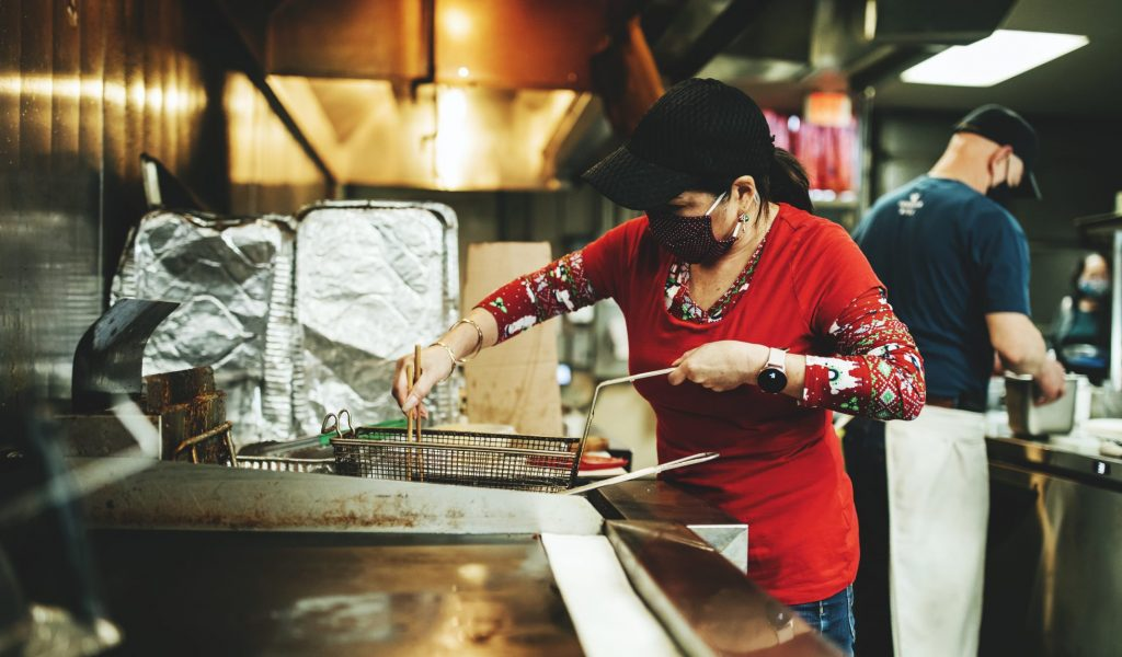 Chef Co cooking a meal at Saimin Says in Renton, WA>